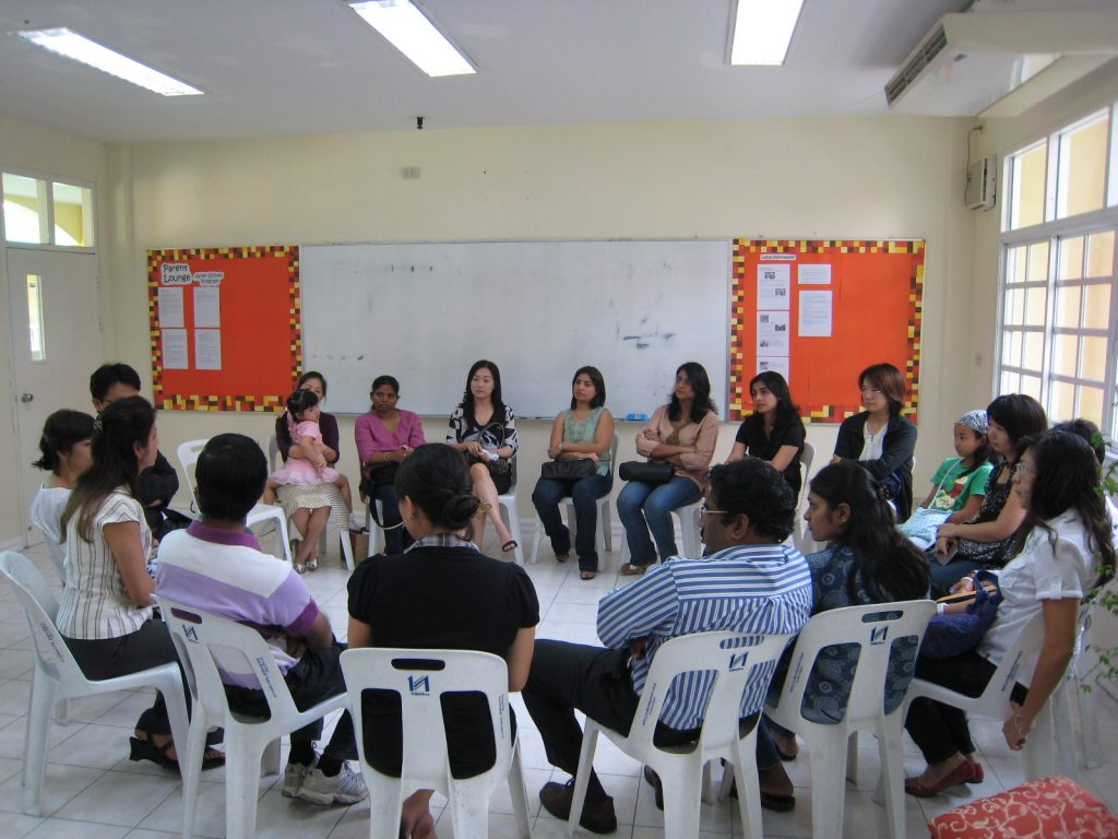 Parents meeting in small groups with homeroom teachers (parents of Grade 1 students)