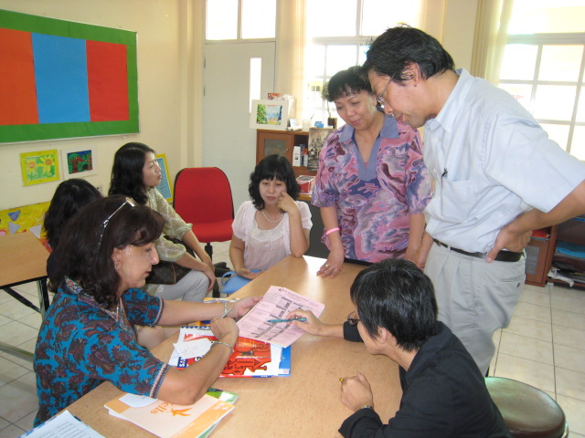 Parents getting familiar with school calendar with the help of IEP teacher