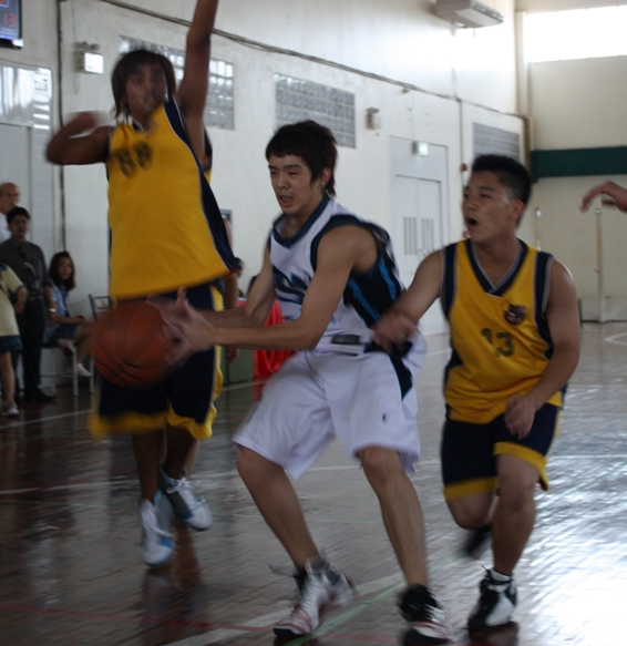 Point guard Boss, grade 10, threads to a couple of St. Andy defenders.