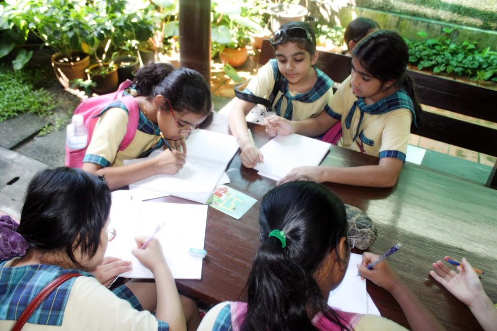 Alana, Muskaan, Chammu, Tina and Anusha taking notes