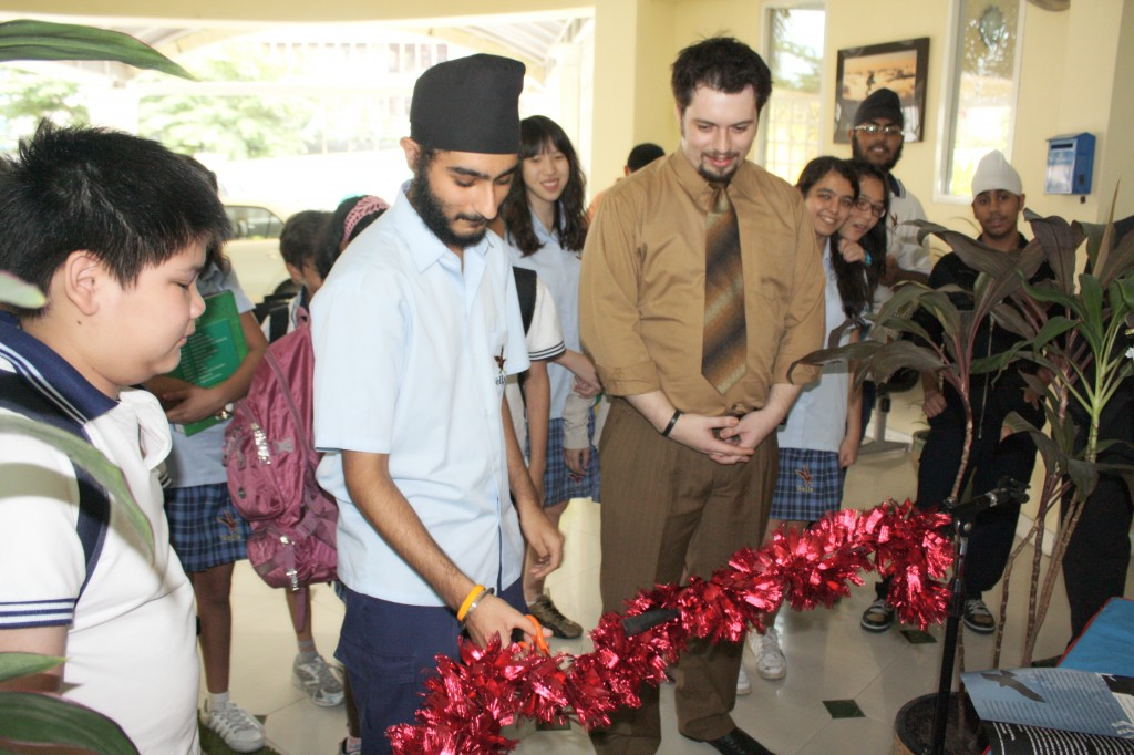 Nick cuts the ribbon to officially release the magazine to the public