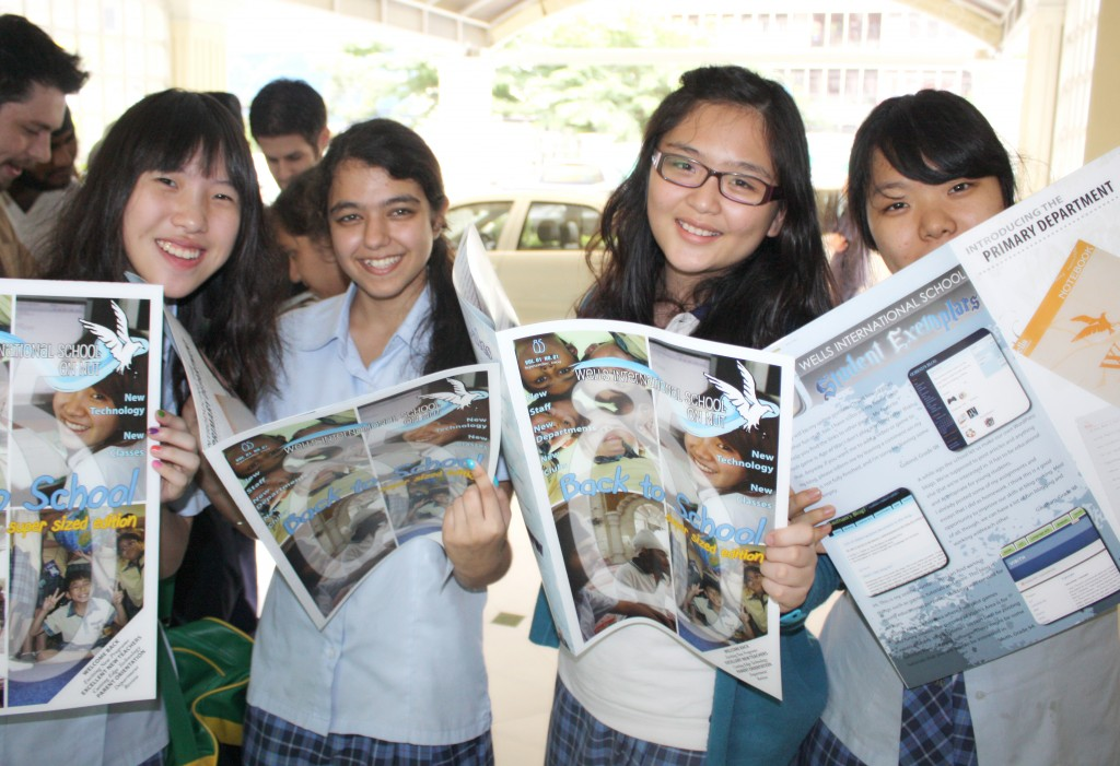 Members of the magazine staff review the results of their hard work