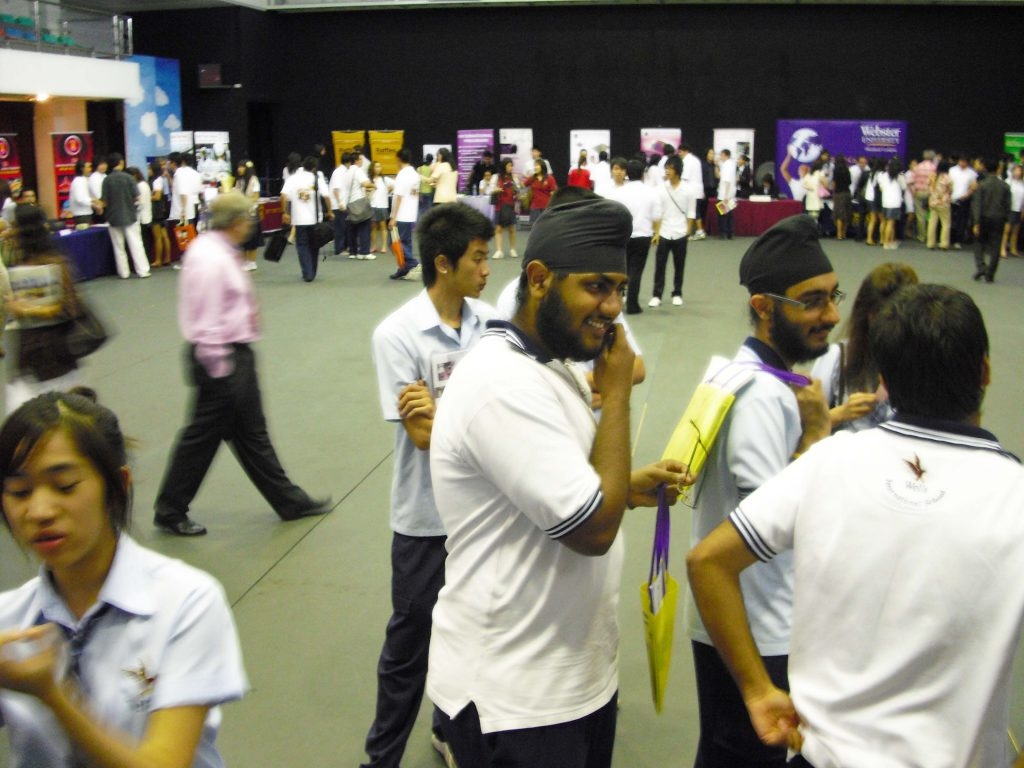 Wells students examining the various university booths