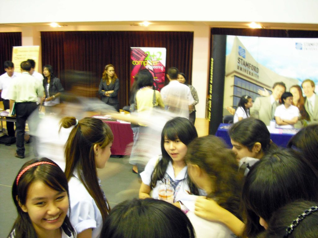 Students discuss the various university programs being offered