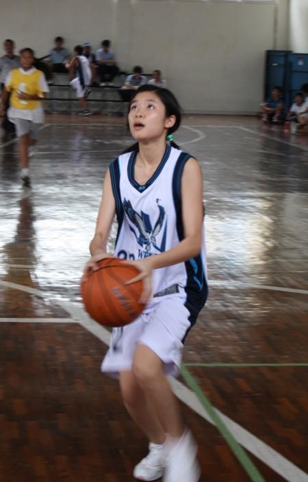 Leading scorer Kanny Smith taking one of her many shots