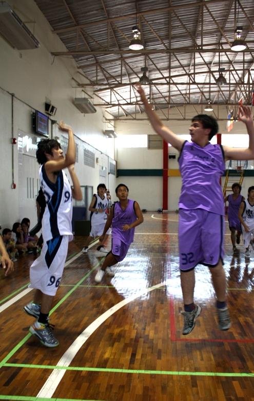 Junior power forward Saran draining a three-pointer.