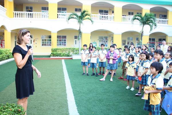 Parent representative giving official speech thanking staff and teachers