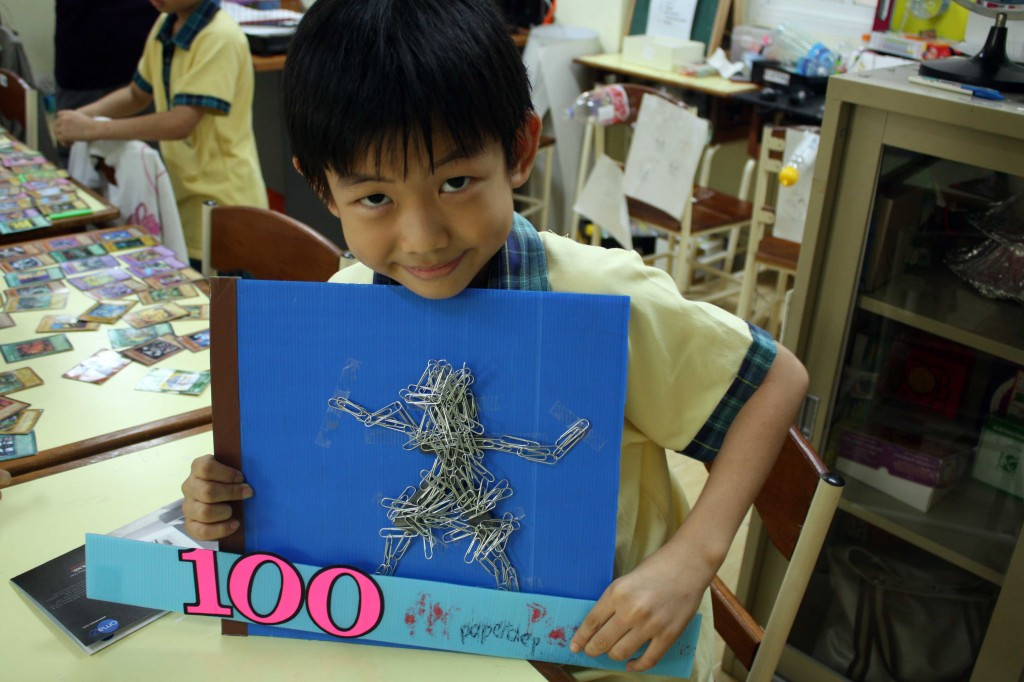 A grade two student showing his 100 Days project