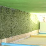Flooring leading to the pool covered with artificial grass to prevent slipping