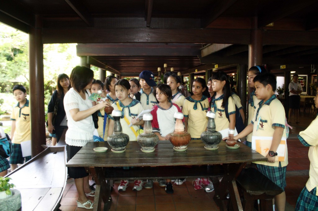 Ms. Jim, our Thai principal, explains how water was stored in the past. The clay pots acted as insulators, keeping water cool.
