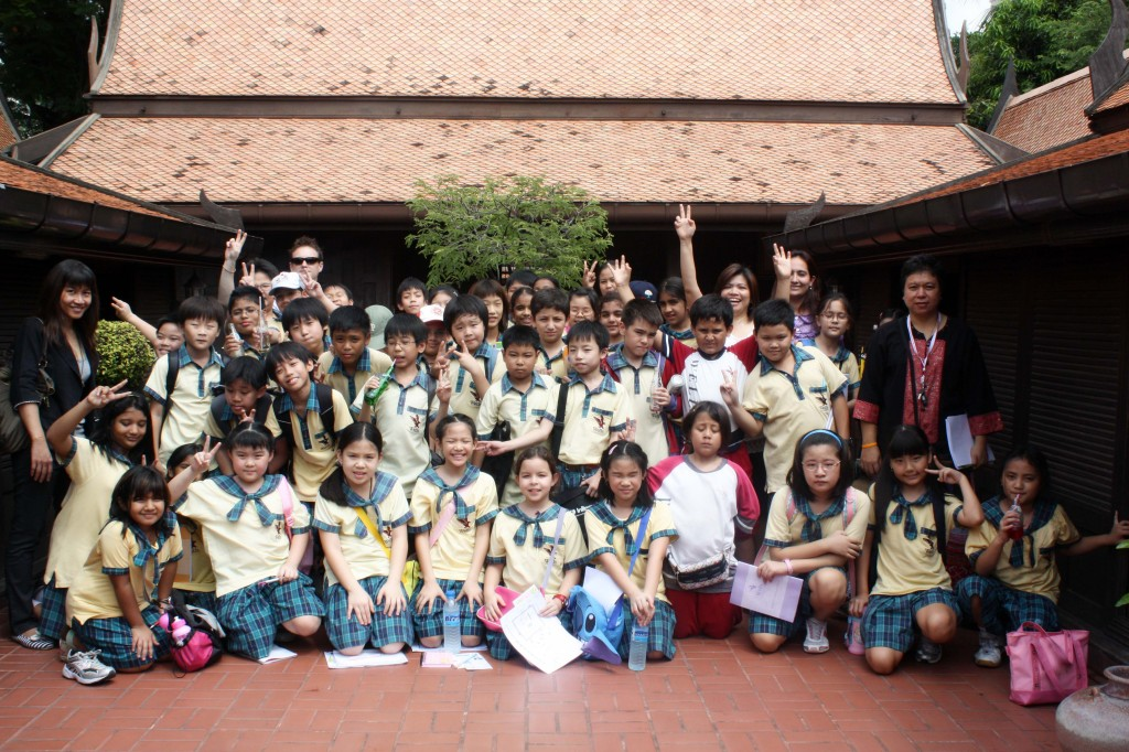 Grade 4 & 5 students with Ms. Jim, Ms. Um, Ms. Au, Ms. Prerna and Mr. Graham in front of the upper level of the Thai house