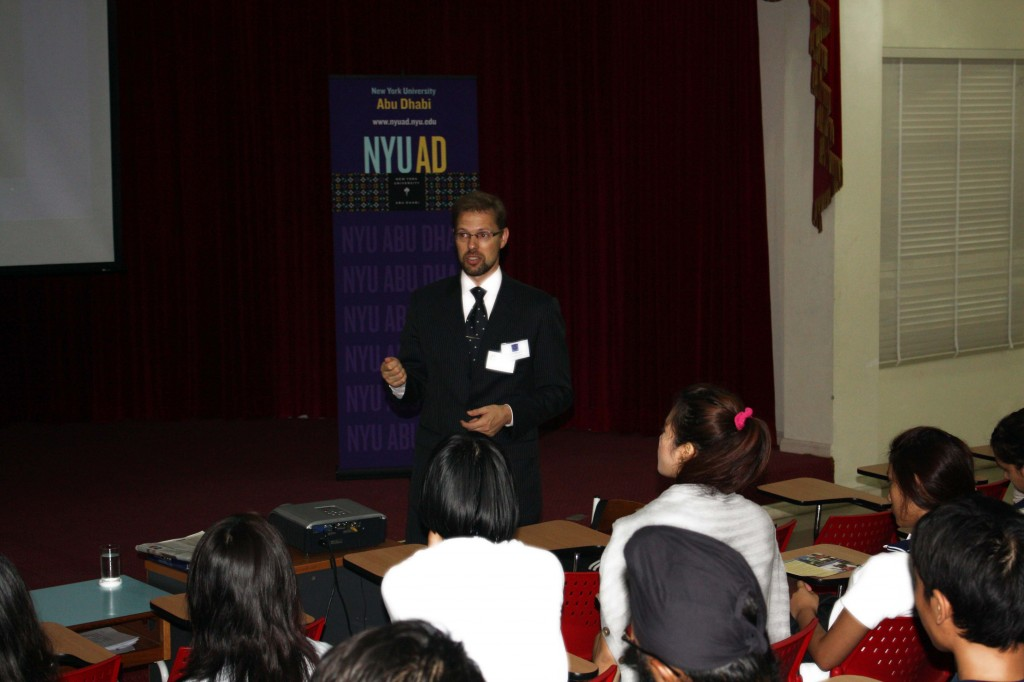 Students listen attentively to the NYU presenter.