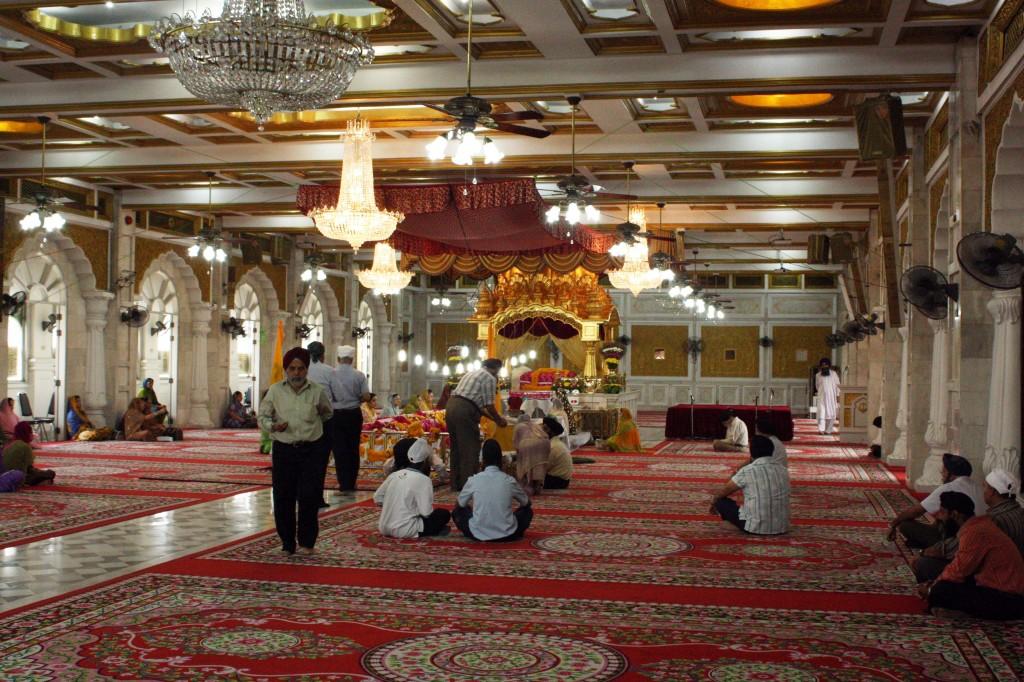 Worshipers listen to the reading of the Guru Granth Sahib.