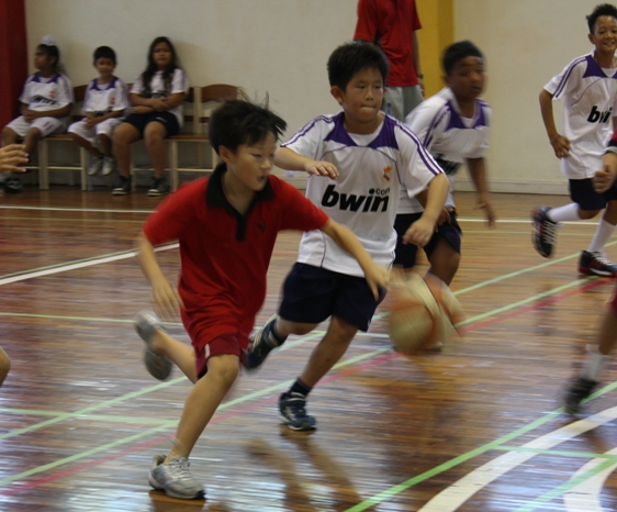 Oscar, grade 4, easily zips past a Rasami defender.