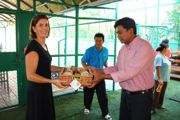 Manager of support staff receives fruit basket on behalf of his personnel