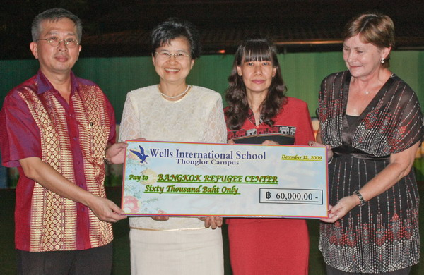 From left: Presentation of check by Mr. Chang Yao-Lang, Chairman, Wells International School to Khun Aumphornpun Buavirat, Program Manager; Khun Charatkorn Mankhatitham, Operation Manager; Ms. Dorothy Laughton, Australian Volunteer -Staff and Curriculum Development from the Bangkok Refugee Center (BRC).