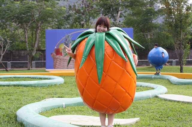 Donning a pineapple outfit, 8th-grader Marin races across the winding path.