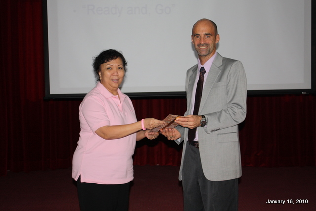 School Director, Ms. Pranee Srisai presenting a token of appreciation to Rick Smith