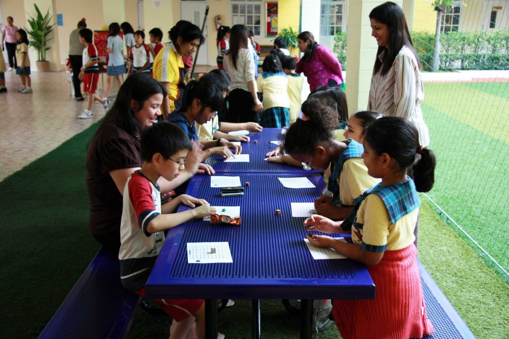 "Teachers, office staff and students play a ""Dice Game,"" organized by Grade 1 students"
