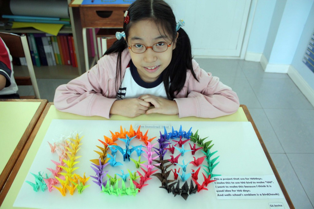 A grade five student  made 100 paper birds to represent 100 days at school